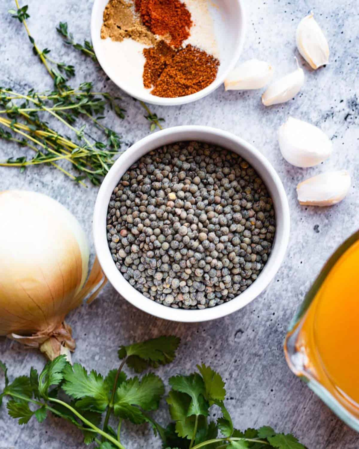 Ingredients for Lentil Chili and Thyme Roasted Corn: spices, fresh thyme, cilantro, dried French lentils, onion, garlic, and vegetable broth.