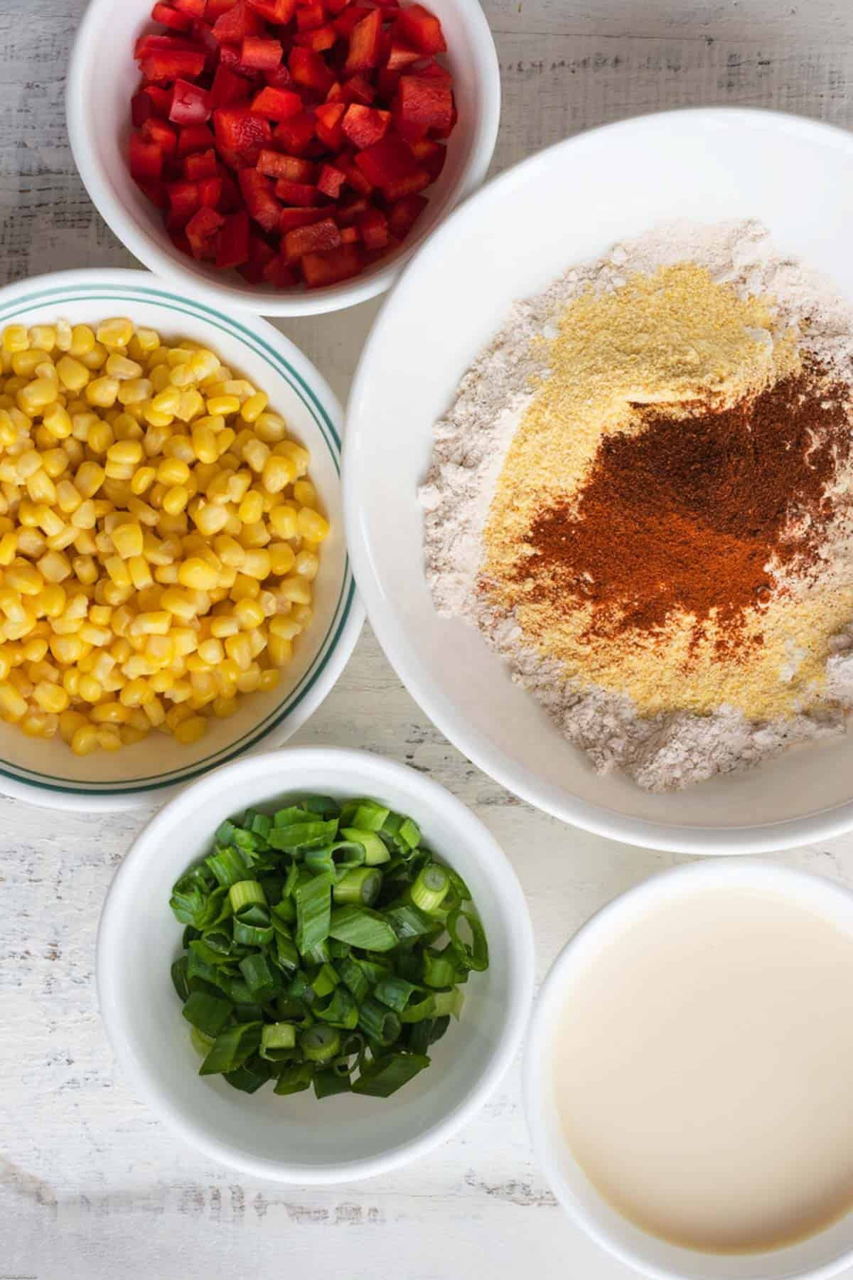 Ingredients: chopped red bell pepper, chopped scallions, corn, soy milk, flour, cornmeal, and spices.
