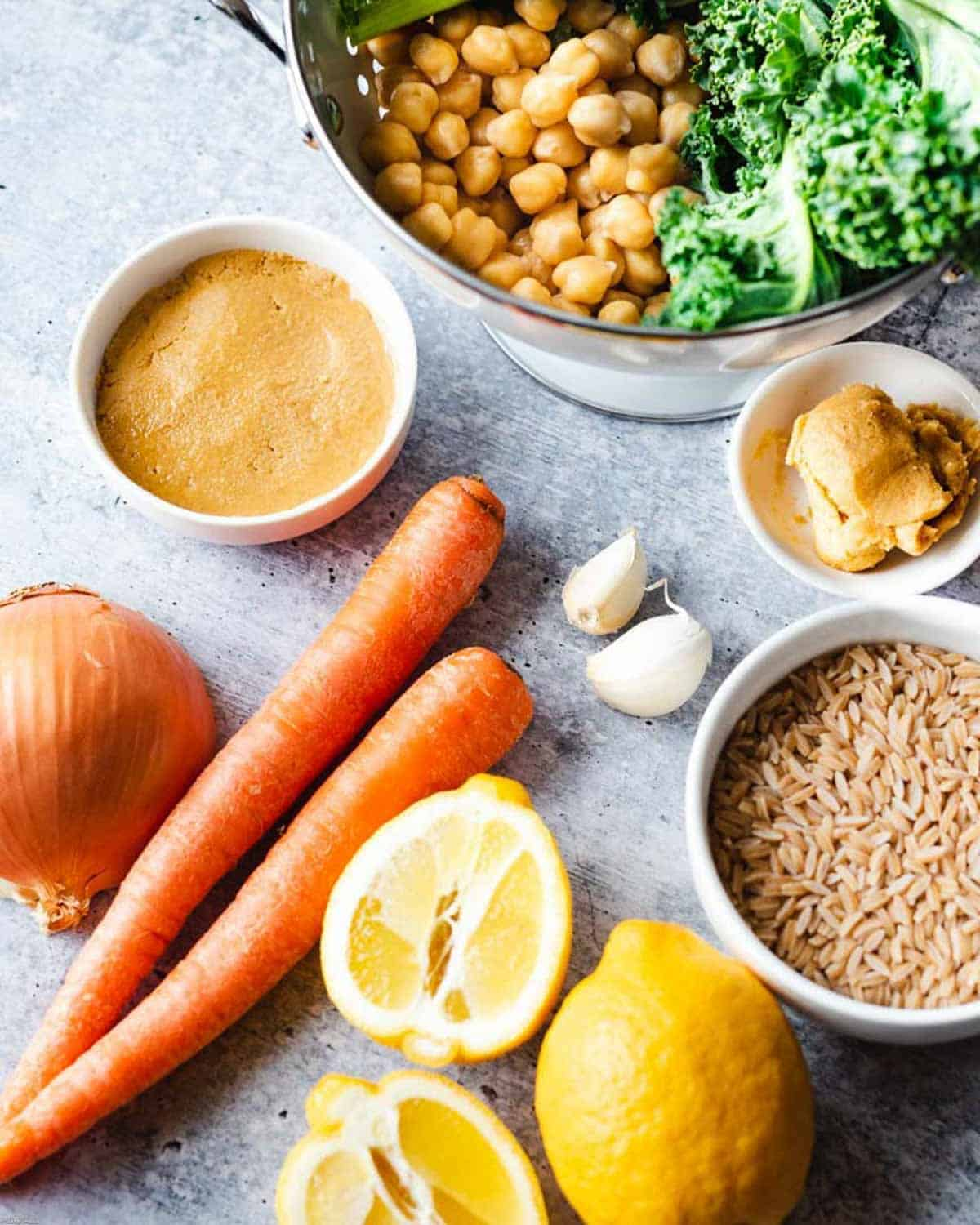 Ingredients for Chickpea Miso Pasta Soup –chickpeas, kale, miso paste, onion, garlic, carrots, orzo, and lemon.