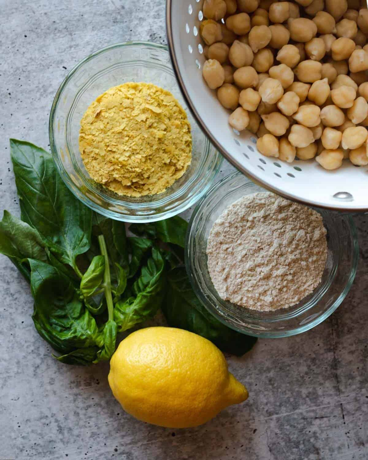 Ingredients for making the patties: lemon, basil, chickpeas, whole wheat flour, and nutritional yeast.