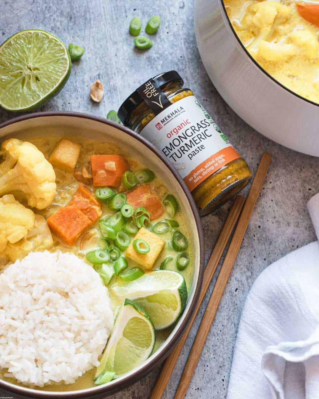Bowl and saucepan with Lemongrass Turmeric Tofu Curry and Mekhala curry paste.