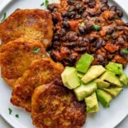 Crispy golden plantain fritters, saucy black bean chili with almond butter, and chopped avocado.
