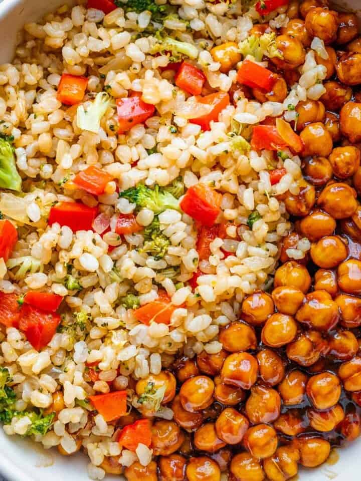 Fried rice with broccoli and red bell pepper paired with saucy chickpeas.