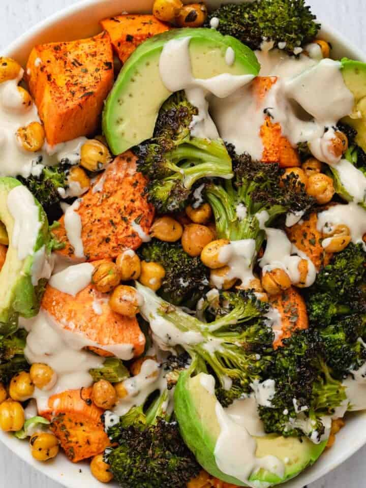 Creamy tahini dressing drizzled over roasted chickpeas & veggies.