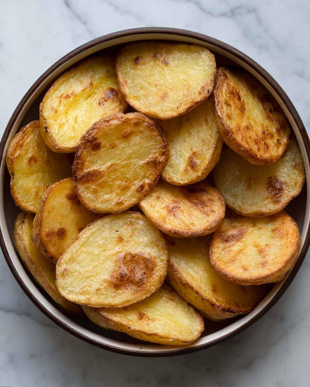 Crispy, golden brown potatoes in a bowl.