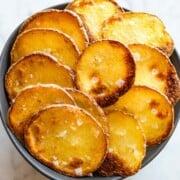 Homemade crispy baked potato chips with Maldon salt.