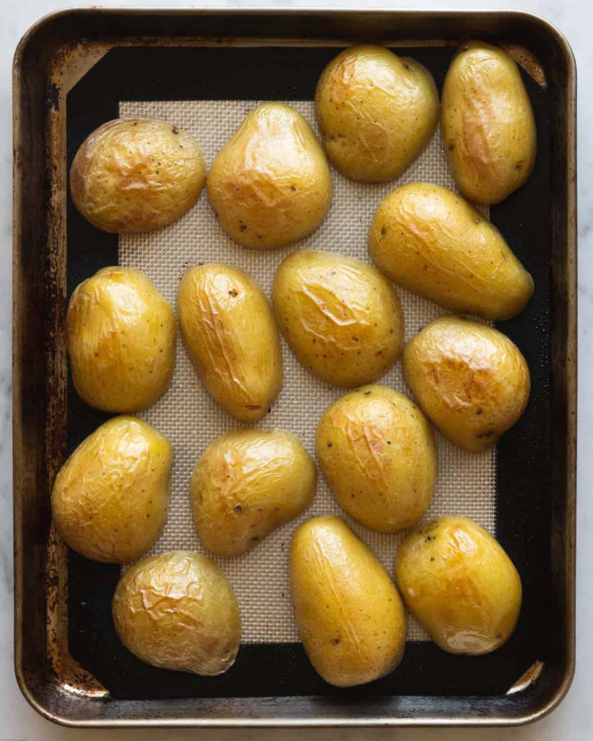 Sliced potatoes turned flat side down for roasting.
