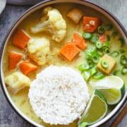 Golden curry with cauliflower, tofu, sweet potato, scallions, fresh lime, and white rice.