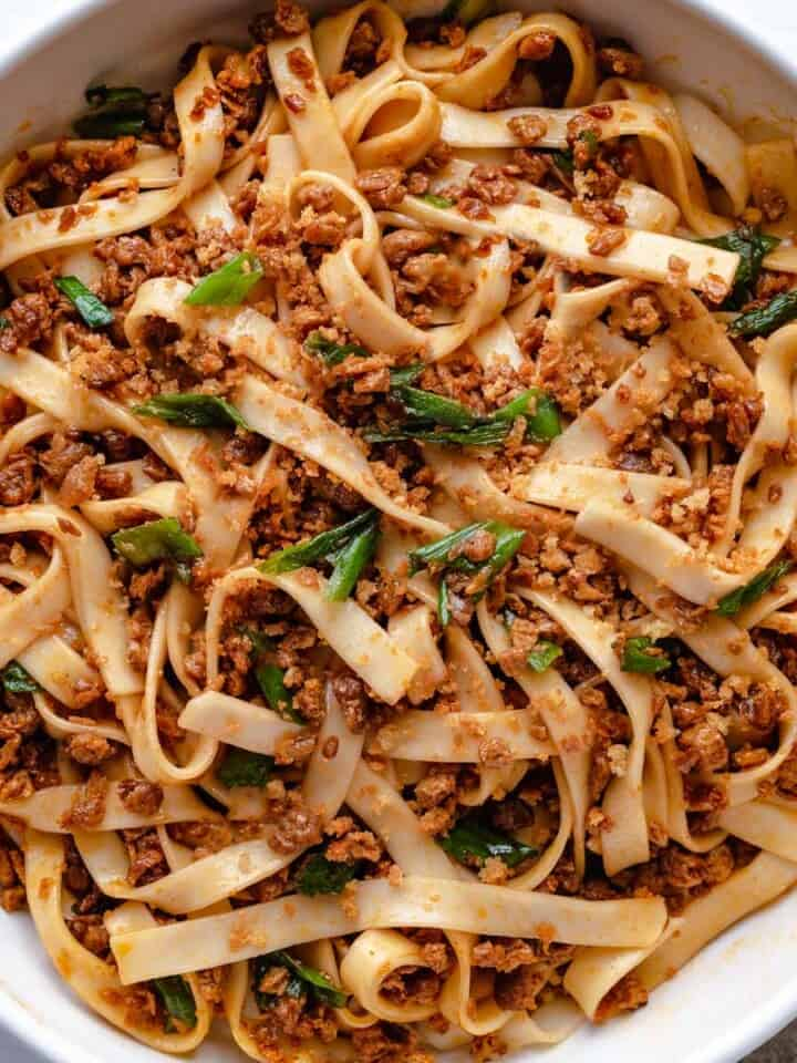 Lo Mein noodles with soy tofu crumbles, chopped scallions, and toasted Panko breadcrumbs in an Asian sauce.