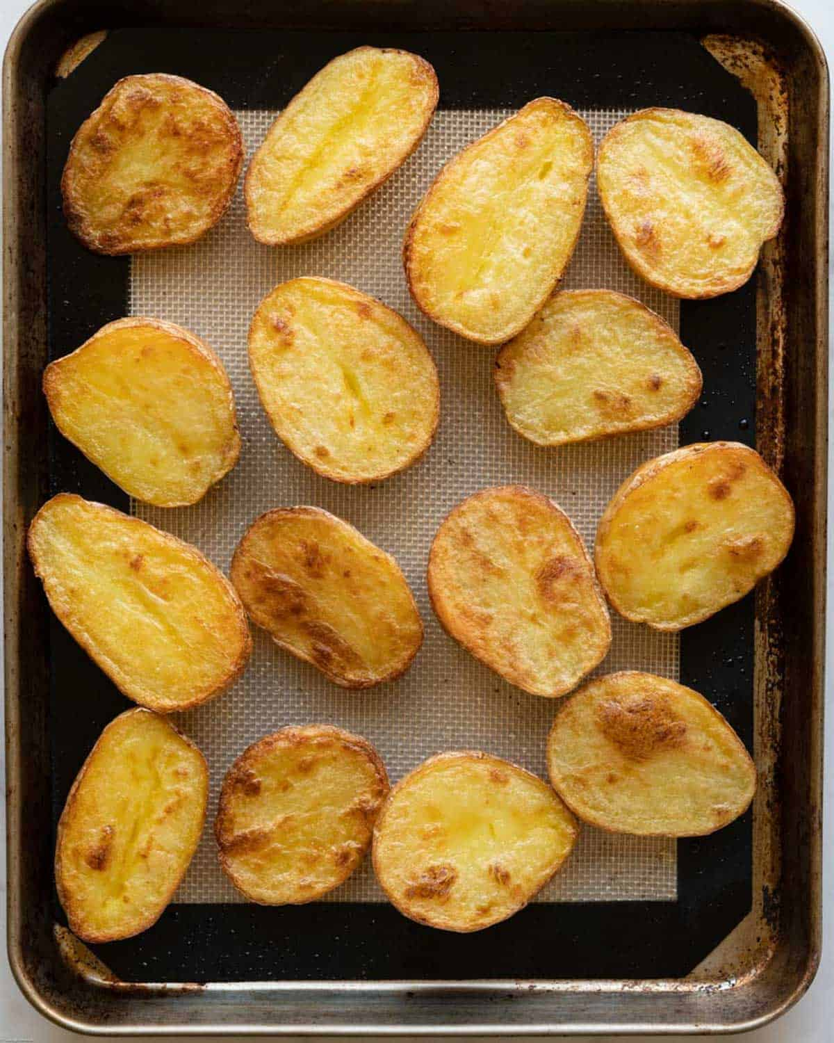 Sliced, crispy, and golden brown roasted potatoes.