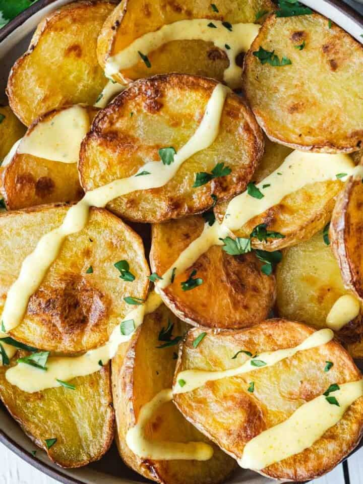 Roast Potatoes with Curry Dressing in a bowl with topped with chopped cilantro.