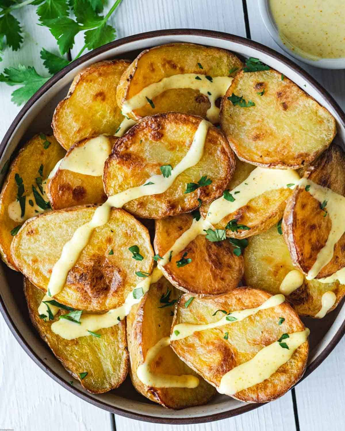 Roast potatoes with creamy curry dressing & chopped cilantro.