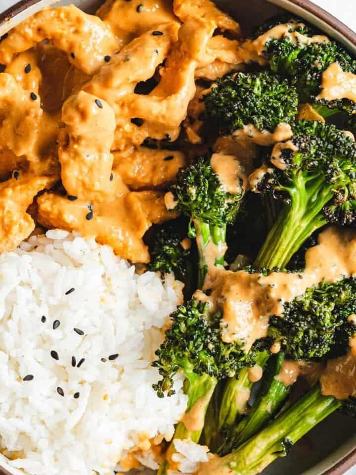 Soy curls, broccoli florets, and white rice in creamy peanut sauce.
