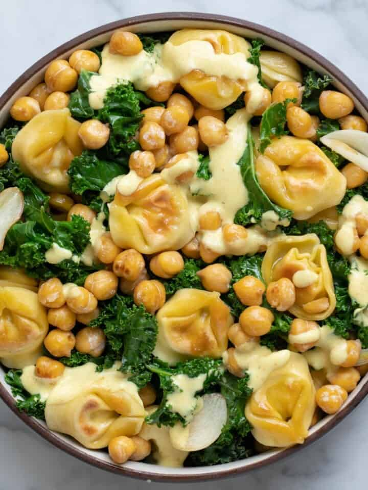 Crispy Tortellini & Chickpea Kale Salad with a generous drizzle of Curry Dressing.
