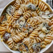 Fusilli pasta with mushrooms in a creamy tofu sauce with chopped rosemary.