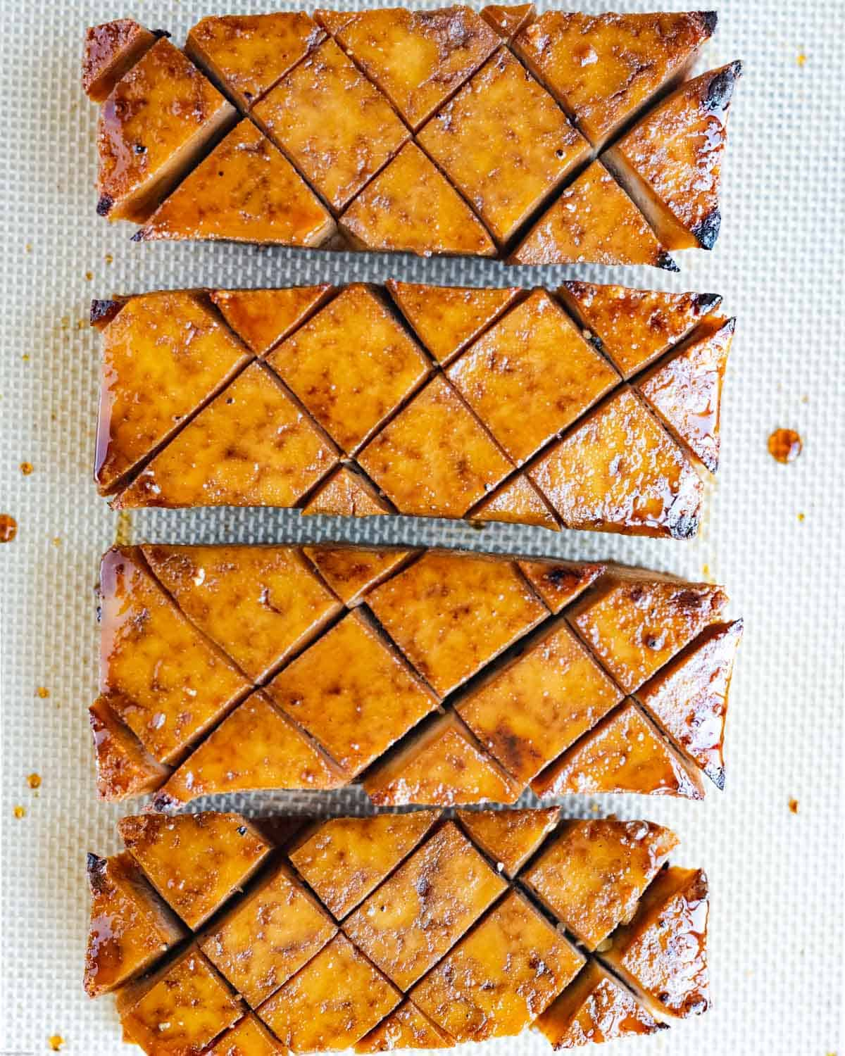 Golden baked tofu steaks in soy sauce and maple syrup marinade.