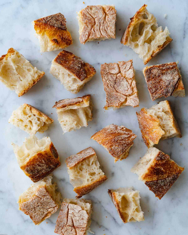Ciabatta-style bread cut into cubes.