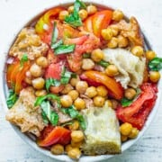 Panzanella salad with roasted chickpeas, bread, tomatoes, basil and olive oil dressing.