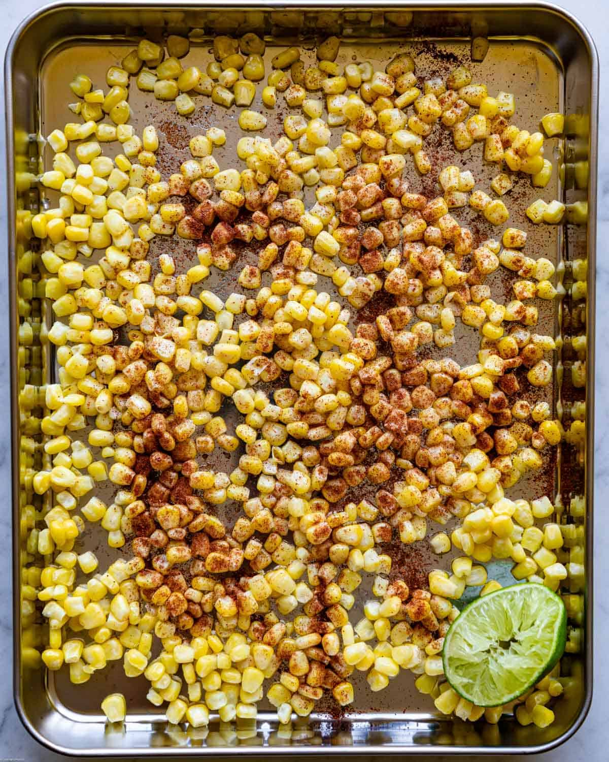 Sweet corn kernels with fresh lime juice, and chili powder.