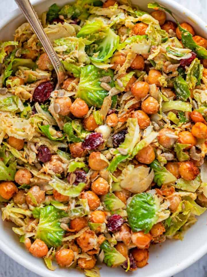 Shredded Brussels sprouts, roasted chickpeas, sunflower seeds, and dried cranberries in creamy vegan Caesar dressing.
