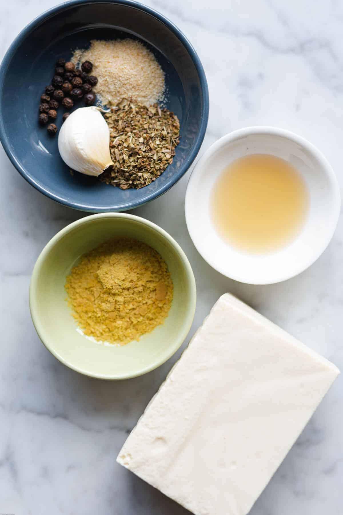Ingredients for Creamy Lemon Pepper Dressing: onion powder, ground mustard seed, dried oregano, silken tofu, black pepper, garlic, apple cider vinegar, and nutritional yeast.