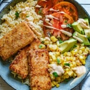 Crispy Tofu Bowl, Chipotle-Tahini, creamy skillet corn, avocado, tomatoes, rice, and cilantro.