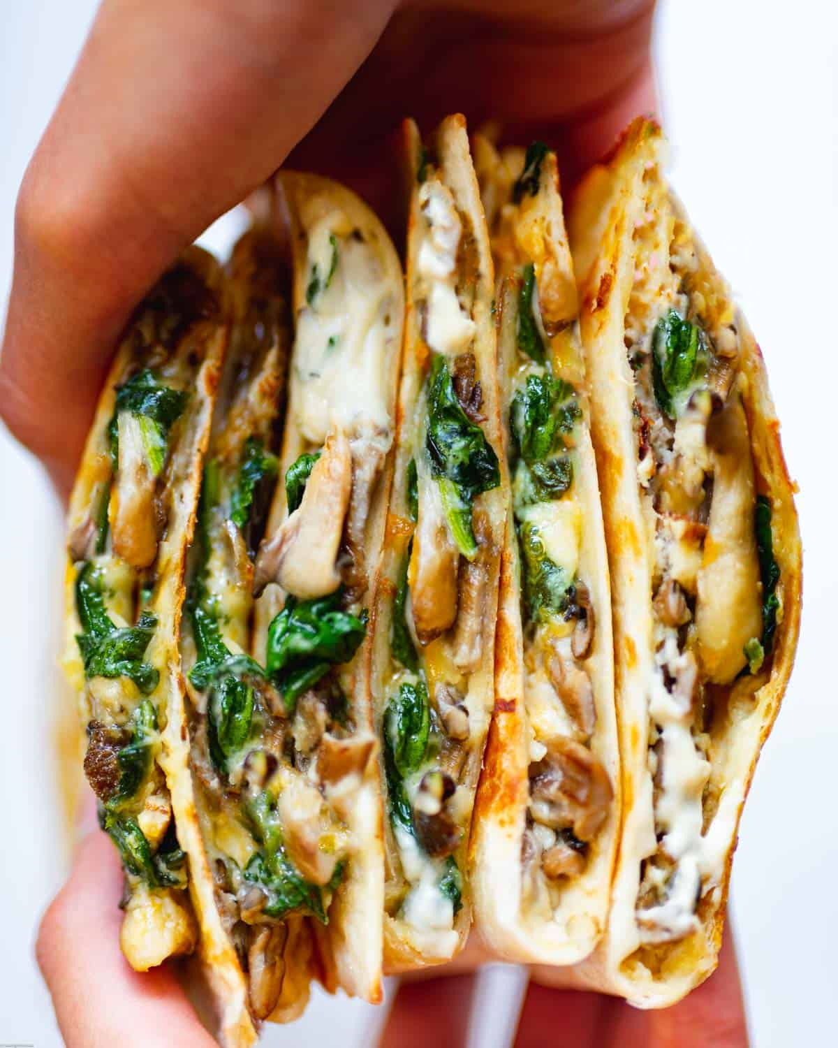 Easy Cheesy Vegan Quesadillas filled with cashew cheese, mushrooms and spinach.