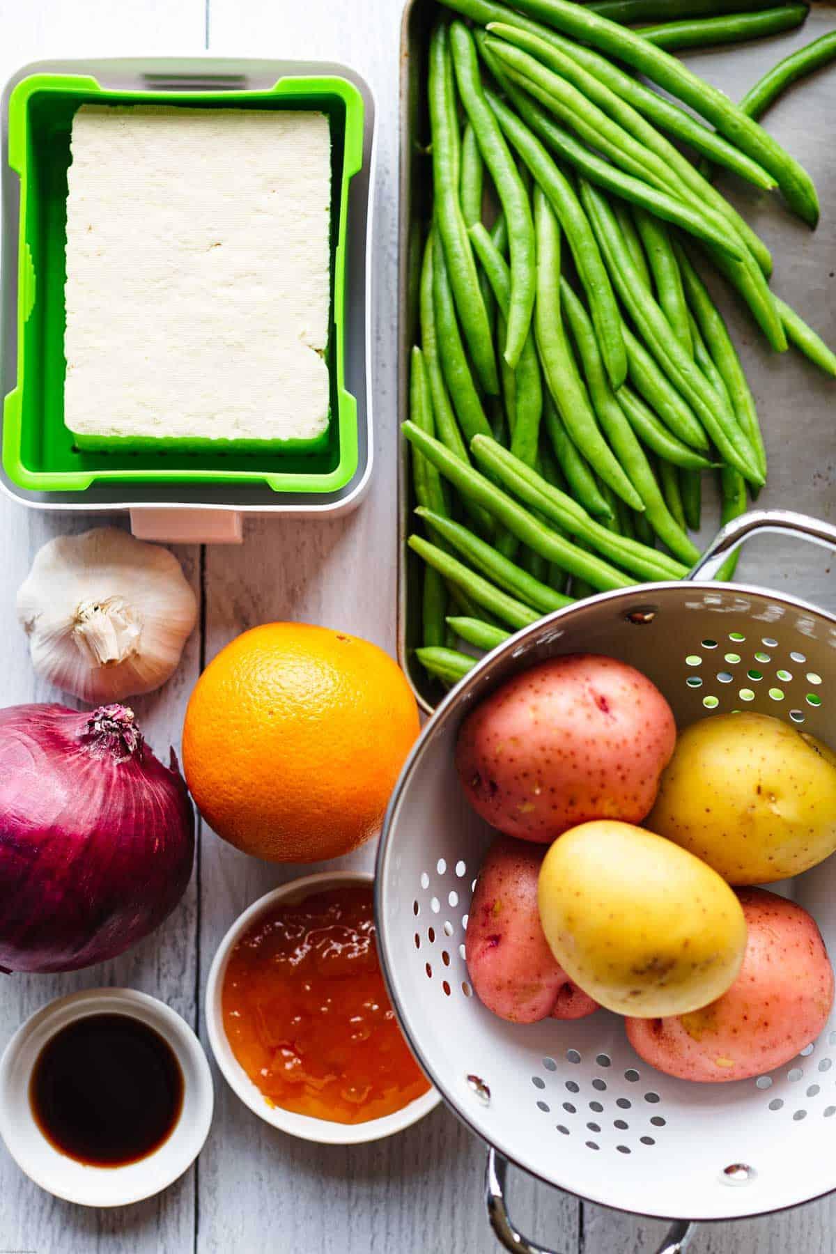 Ingredients: Tofu, green beans, Yukon Gold potatoes, red potatoes, orange, peach preserves, red onion, garlic.