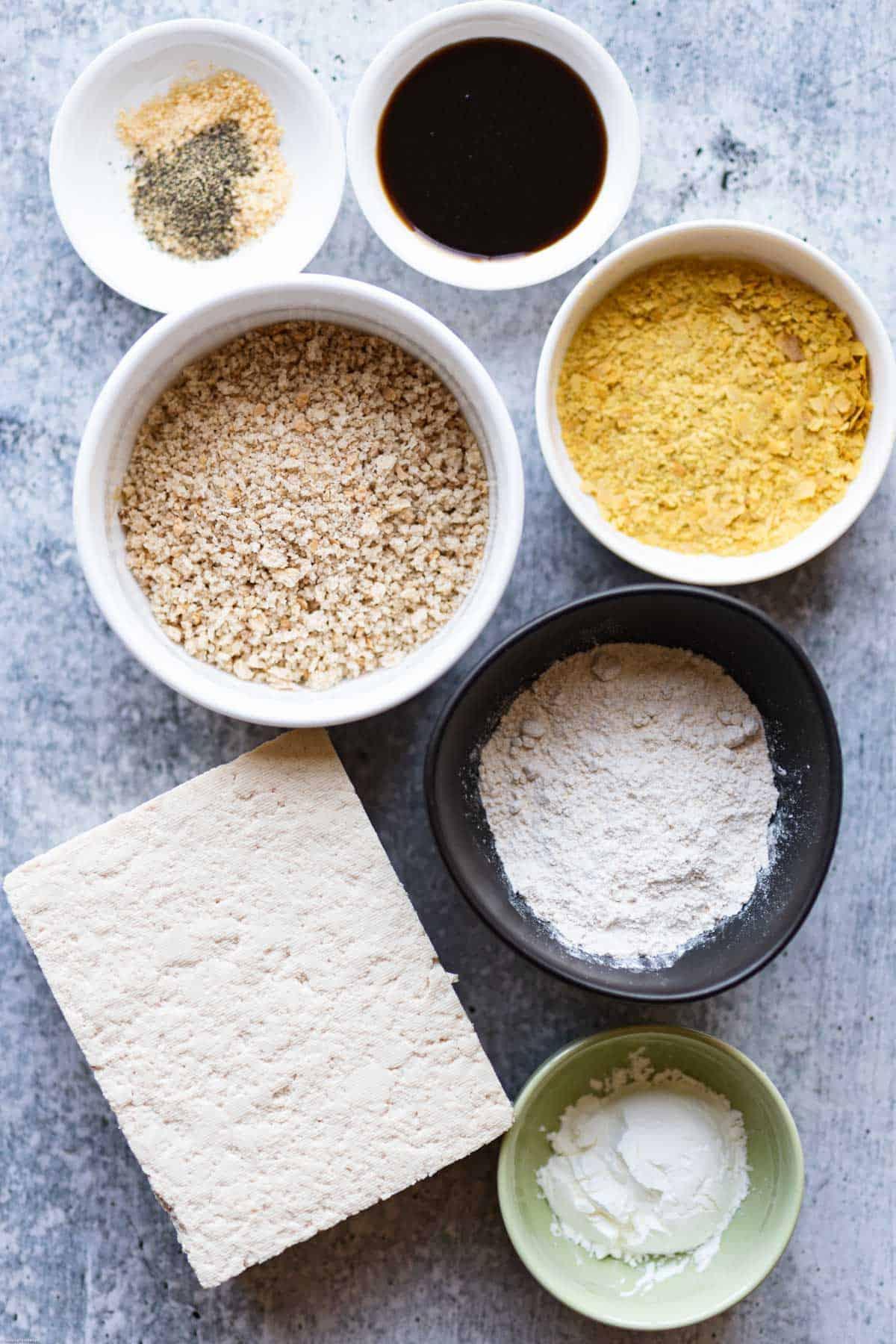 Tofu, panko, cornstarch, flour, nutritional yeast, coconut aminos, black pepper, onion powder, and garlic powder.