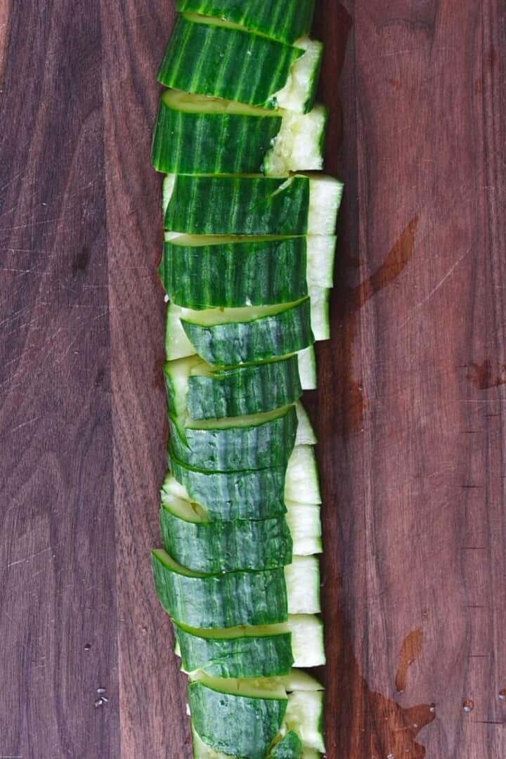 Smashed and sliced cucumber for adding to salad.