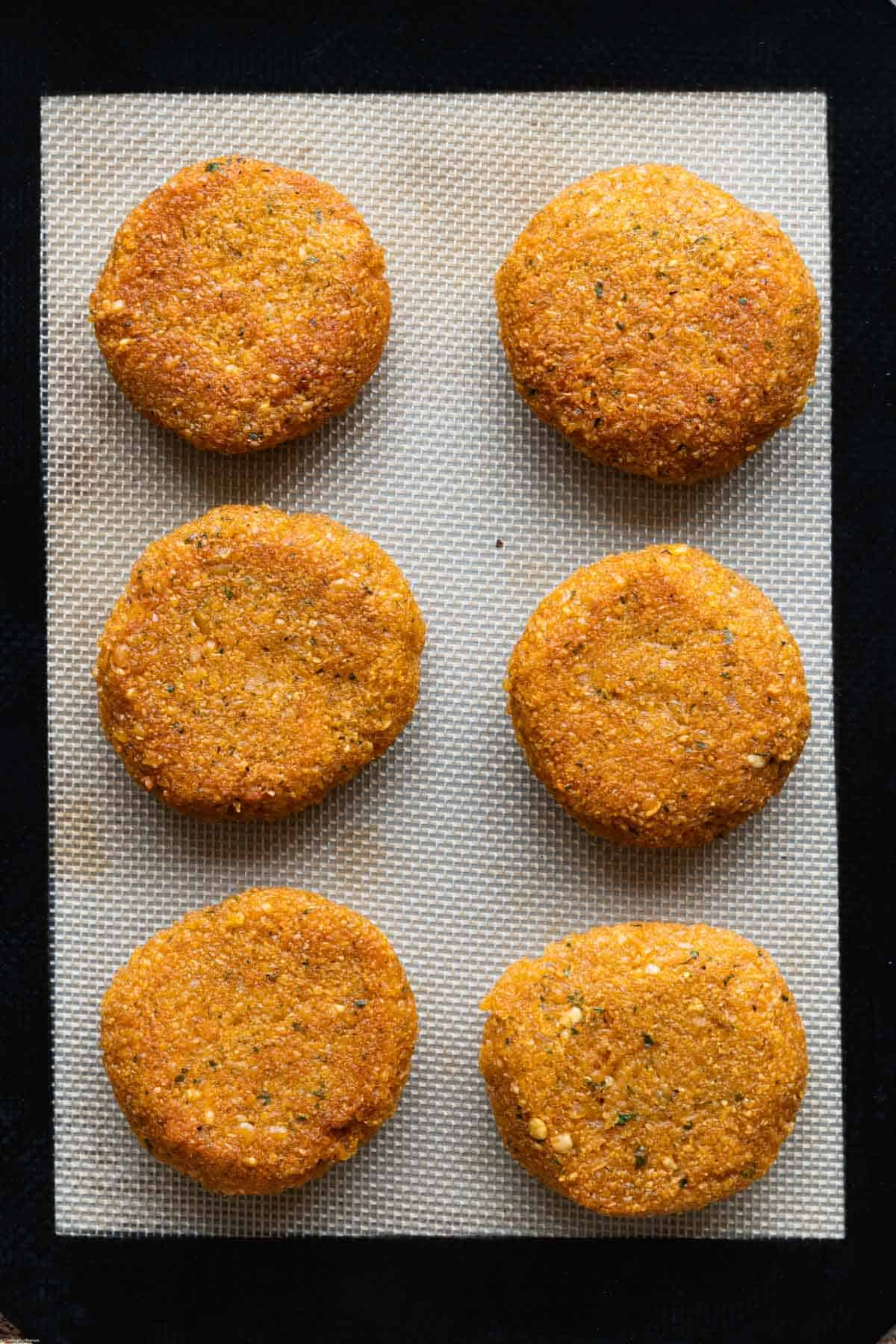 Baked Easy 6-Ingredient Lentil Burgers on a silicon mat.