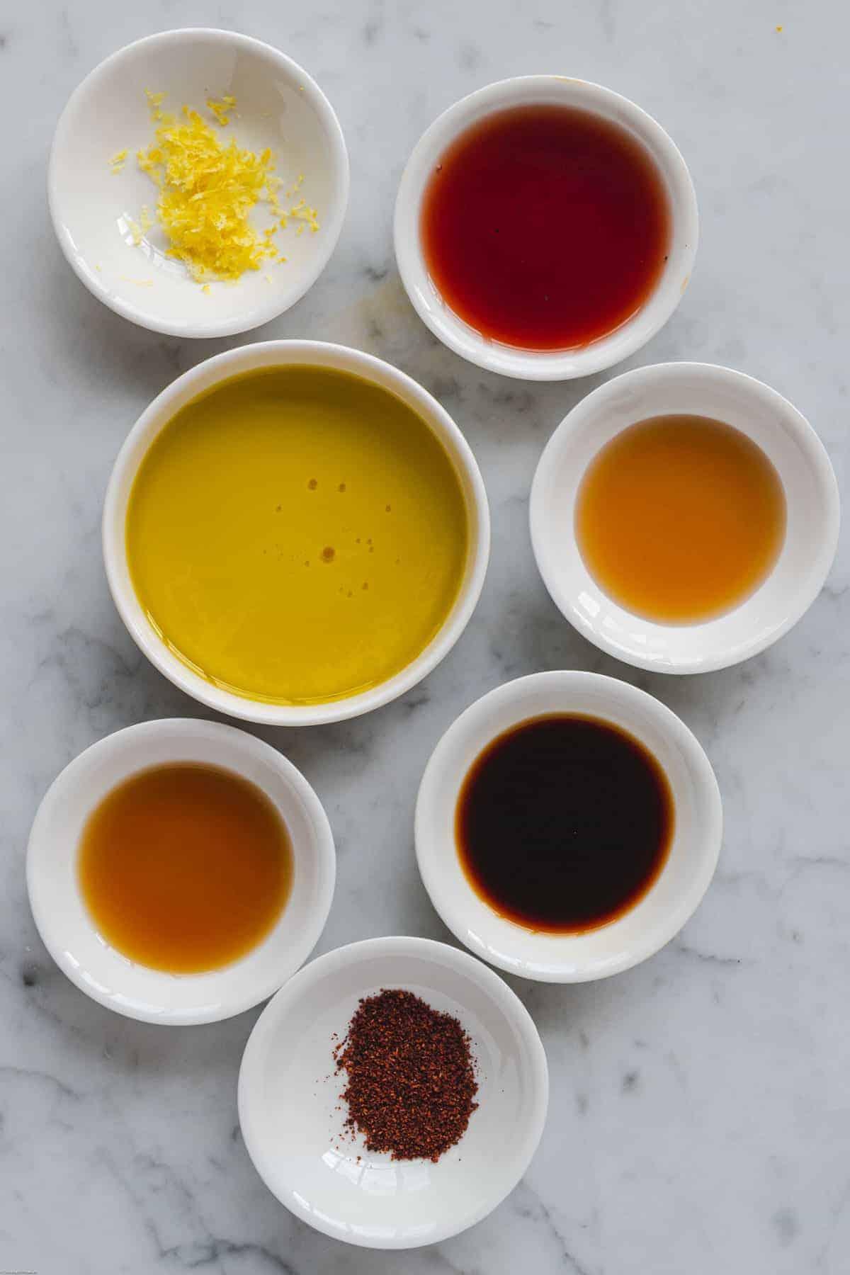 Ingredients for the salad dressing: Lemon zest, seasonings, tamari, olive oil, toasted sesame oil, balsamic vinegar, maple syrup.