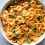 Healthy Sweet Potato Pasta & Miso sauce with bow-tie pasta in a white bowl.