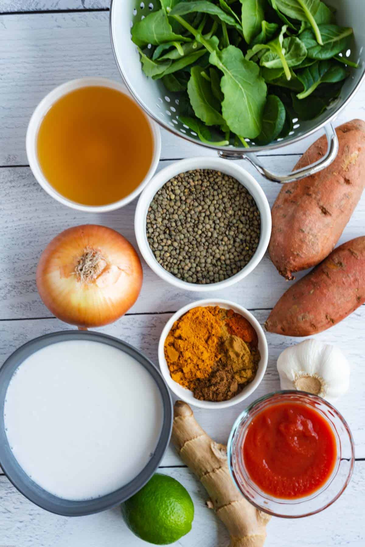 Ingredients: spinach, lime, tomato sauce, ginger, garlic, onion, lentils, sweet potato, coconut milk, veggie broth, and spices.