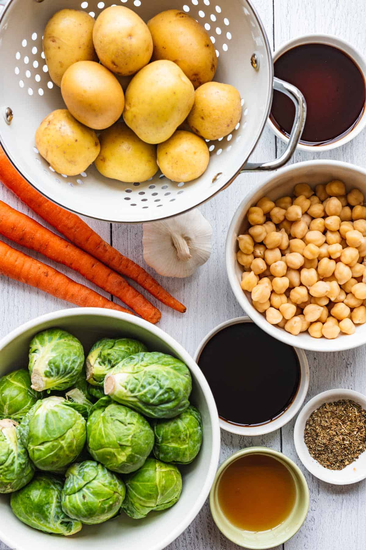 Brussels sprouts, potatoes, carrots, garlic, balsamic vinegar, coconut aminos, dried herbs, maple syrup, and legumes.