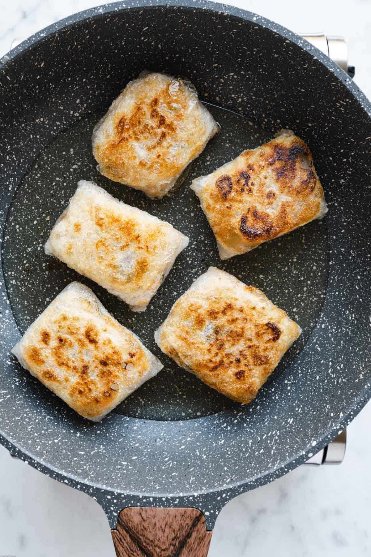 Pan-fried Easy Vegan No-Chop Dumplings in a skillet.