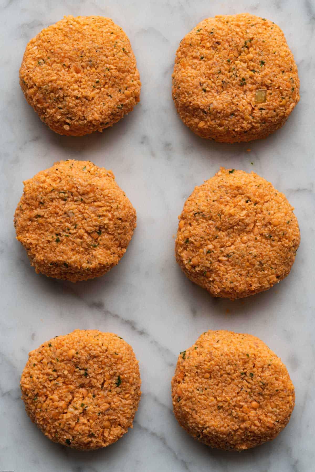 Six Easy 6-ingredient lentil patties ready to bake.