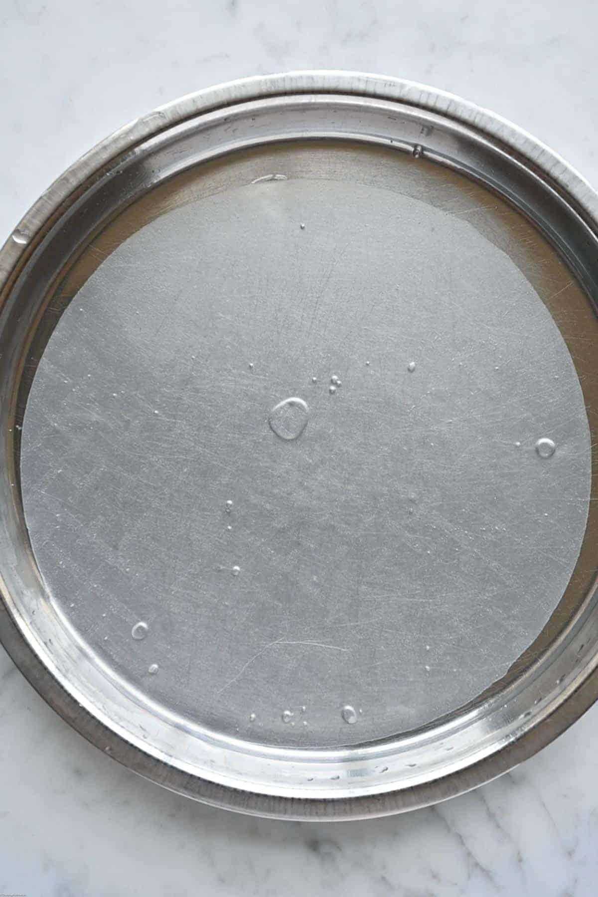 Rice paper soaking in water for making Easy Vegan No-Chop Dumplings.