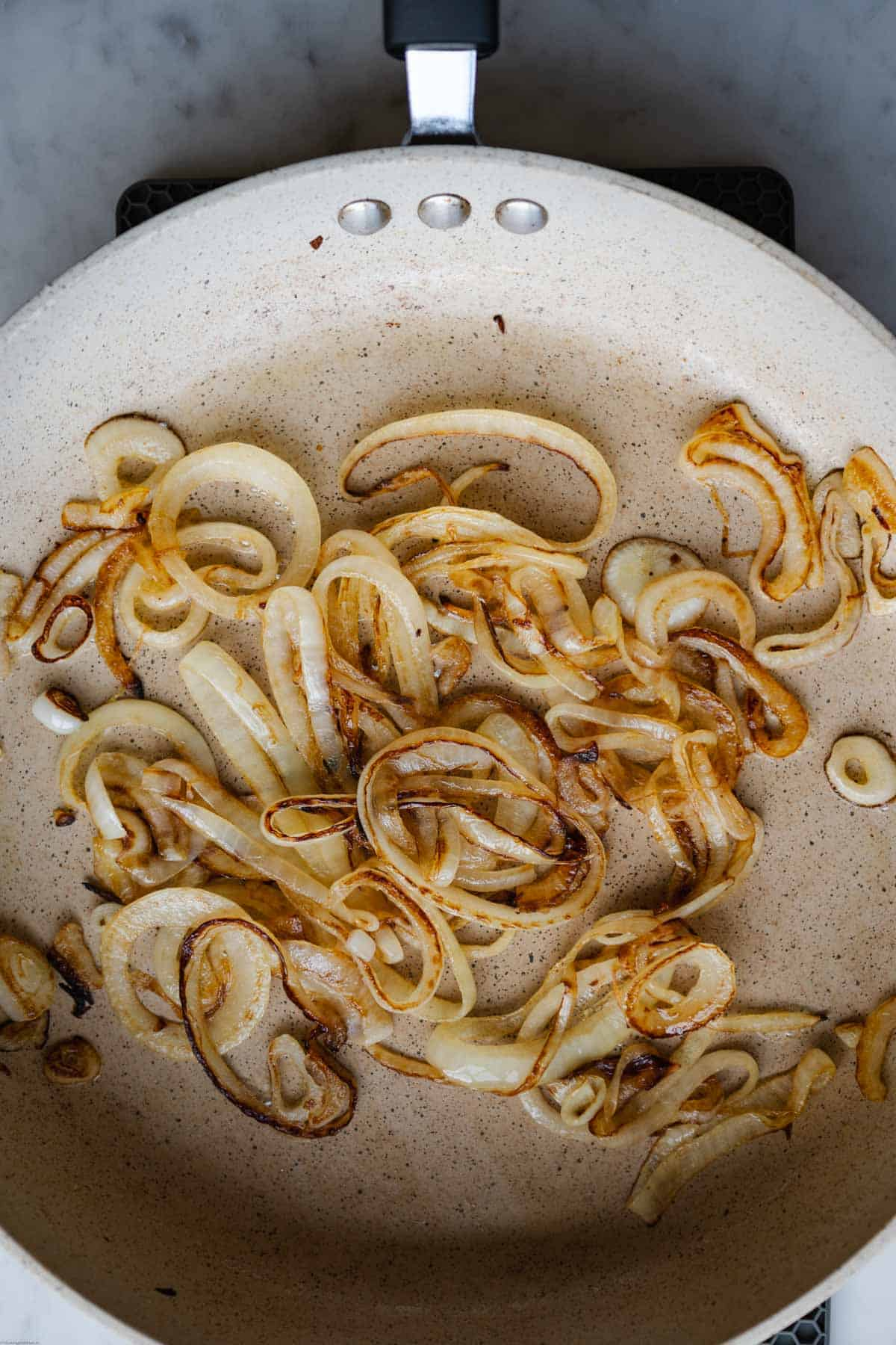 Caramelized onions in a large skillet.