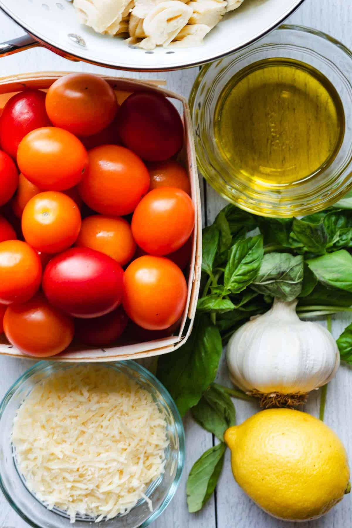 Grape tomatoes, cashews, vegan parmesan, lemon, garlic, fresh basil, and olive oil.