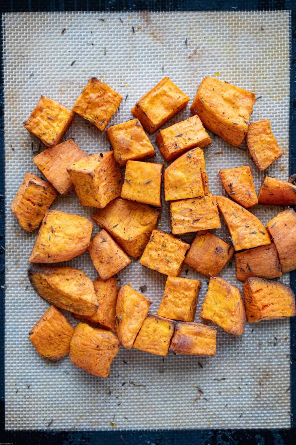 Roasted sweet potato on a baking sheet.